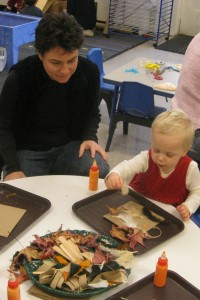 picture of a two year old engaging in crafts at the Marylhurst School